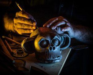 Odd Rodney sculpting the monkey head bottle.
