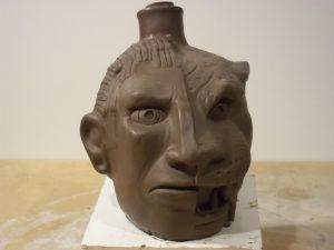 A clay sculpture of the original Apacalypto Tequila half Mayan, half jaguar bottle design by Odd Rodney.