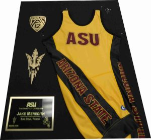 ASU wrestling jersey display with a plaque engraved by Tempe Trophy.