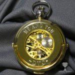 Engraved skeleton gold pocket watch