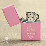 "Engraved pink zippo lighter that says ""You light up my life"""